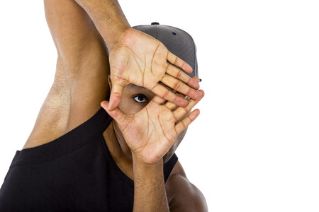 looking through frame: Fit urban dance teacher gesturing a frame like he is planning a choreography Stock Photo
