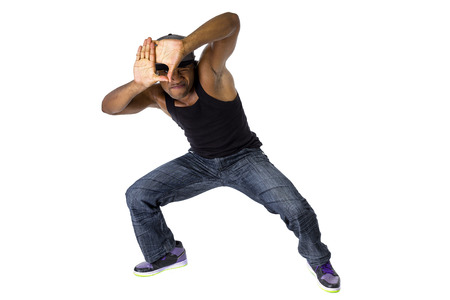 Fit urban dance teacher gesturing a frame like he is planning a choreography Banque d'images
