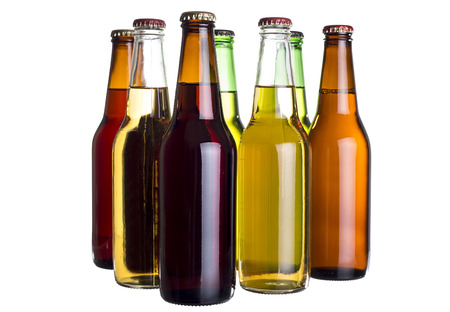 6 pack beer: Group of unlabeled variety of beer bottles isolated on a white background