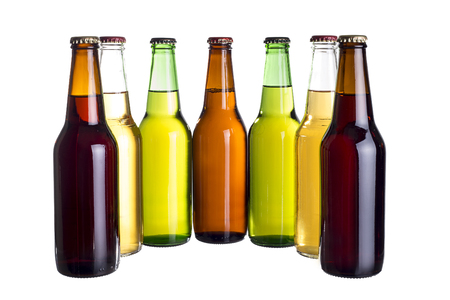 unlabeled: Group of unlabeled variety of beer bottles isolated on a white background