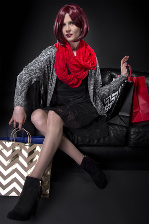 splurge: Redhead with Shopping Bags on a Black Leather Couch