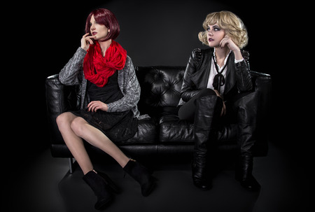 juxtaposition: Conservative female model snobbish to a younger model in goth punk fashion clothing