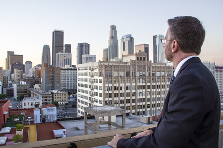 gentrification: Businessman or architect looking at real estate gentrification zone of Downtown Los Angeles
