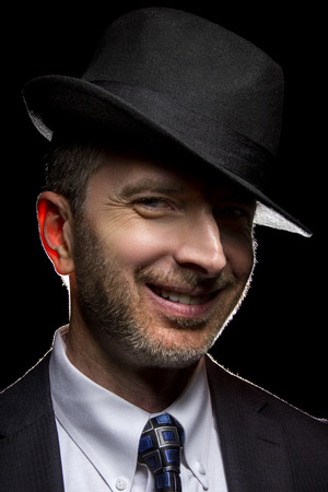 fedora: Man wearing a fedora hat as a film noir detective or gangster Stock Photo