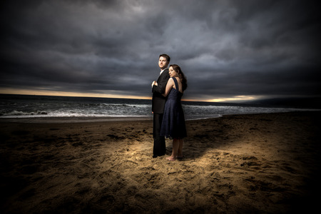 engaged: Loving engaged couple on honeymoon in a dramatic HDR beach island landscape Stock Photo