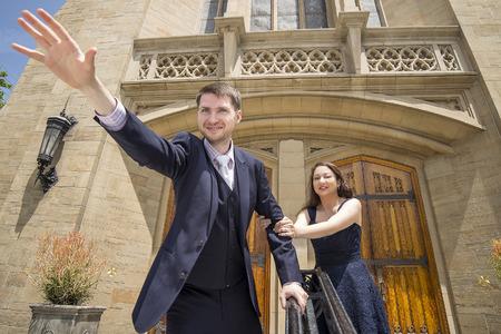 run away: Funny groom pretending to run away from bride on wedding day Stock Photo