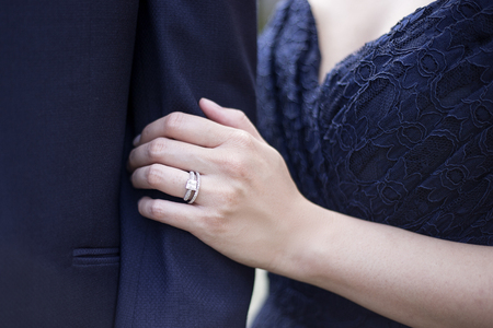 engaged: Engaged male and female hands showing off engagement ring in a romantic pose Stock Photo