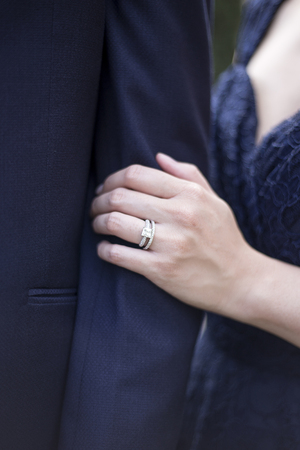 Engaged male and female hands showing off engagement ring in a romantic pose Imagens