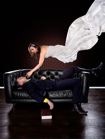 passed out: Man dreaming on a couch of a girl in a wedding dress floating and descending to him