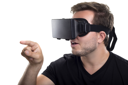 ar: Gamer touching something while wearing interactive virtual reality headset