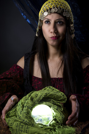 astrologist: Fortune teller looking upset or confused because of the bad news she is predicting
