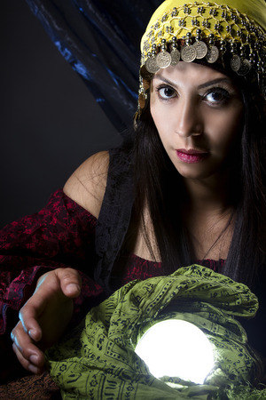 diviner: Woman dressed in a Halloween costume as a fortune teller gypsy