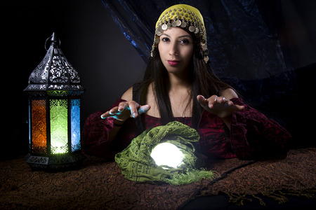 esoterism: Woman dressed in a Halloween costume as a fortune teller gypsy