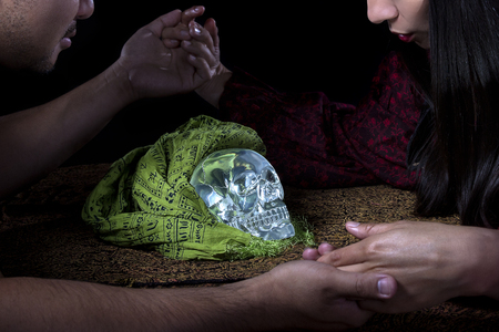 palmist: Psychic or fortune teller gypsy with a client doing a seance telepathic ritual