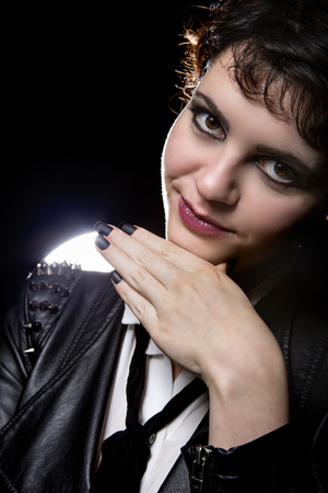 subculture: Goth style punk female wearing black manicure or press on nail art on fingernails