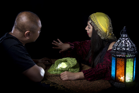 psychic: Gullible male client is giving a fraudulent psychic a diamond ring Stock Photo