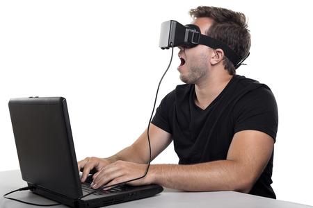 virtual reality simulator: Virtual Reality gamer wearing headset tethered to a gaming pc Stock Photo