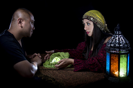 Psychic reading with a fortune teller and superstitious client.  Astrology. Divination.