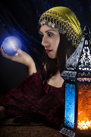diviner: Psychic or diviner staring at a crystal ball to predict destiny or future.  Astrology. Fortune Teller.