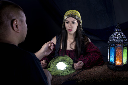 diviner: Female psychic is surpised of her own future when client proposes engagement to her