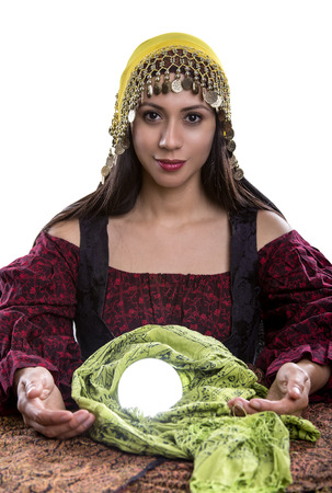 psychic: Female psychic or fortune teller with a crystal ball on a white background
