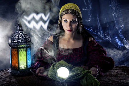 psychic: Psychic or fortune teller with crystal ball and horoscope zodiac sign of Aquarius