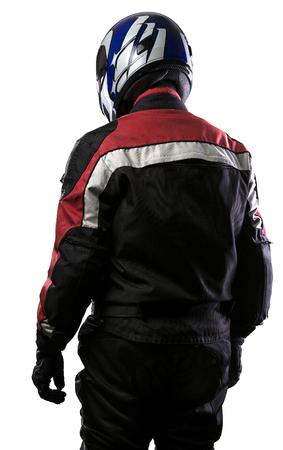L'uomo indossa una pelle e tessuto tuta protettiva per auto da corsa e gli sport a motore motociclistico. L'ingranaggio è blindato con un casco e indossati da motociclisti e autisti professionali. L'uomo è isolato su uno sfondo bianco. Archivio Fotografico - 71232465