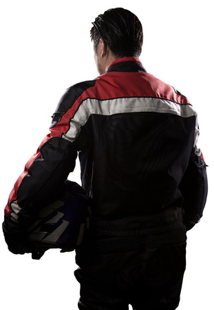 gran prix: Man wearing a protective leather and textile racing suit for race cars and motorcycle motor sports.  The gear is armored with a helmet and worn by bikers and professional drivers. The man is isolated on a white background.