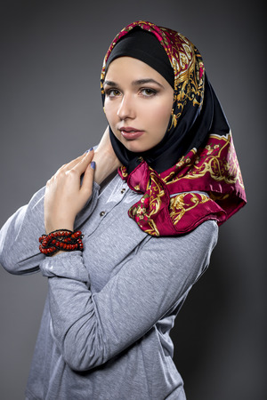 conservative: Fashion model wearing hijab for conservative modern clothing mostly associated with muslims, middle eastern and east european culture.  The outfit depicts the traditional headscarf in vogue style.
