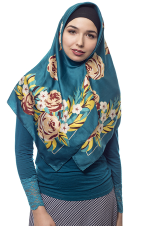Fashion model wearing hijab for conservative modern clothing on a white background.  The style is associated with muslims, middle eastern and east european culture.