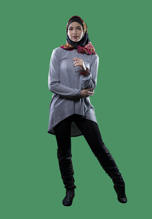 religious clothing: Woman wearing conservative traditional hijab with modern style clothing.  The head scarf is associated with islamic religious traditions and middle eastern or east european cultures.