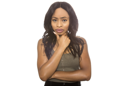 Black female isolated on a white background displaying failure facial expressions.  She is young and of African American ethnicity. Stock Photo