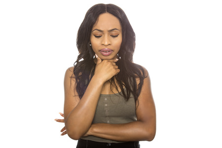 adult oops: Black female isolated on a white background displaying failure facial expressions.  She is young and of African American ethnicity. Stock Photo