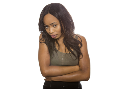 Shy Black female isolated on a white background displaying facial expressions.  She is young and of African American ethnicity.