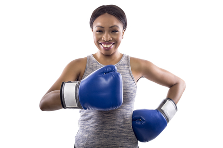 Black female on a white background wearing boxing gloves with thumbs up.  Part of image set for gritty woman series.