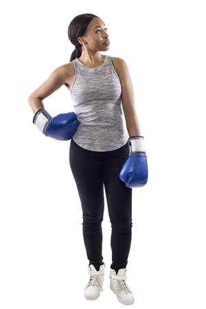 Black female on a white background wearing boxing gloves advertising with copy space.  Part of image set for gritty woman series.