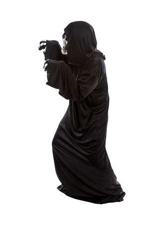 The grim reaper or death halloween costume isolated on a white background.  The skeleton is wearing a hooded black robe. He is doing funny scary poses. Imagens