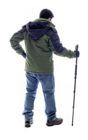 Mountain Climber or Hiker looking at a white background for composite.  The man is isolated and acting like he is looking at a view to depict outdoor activity and adventure. Standard-Bild