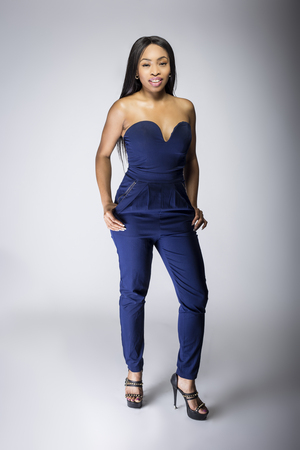 Sexy black female fashion model wearing apparel with blue pants. The outfit is modern style for spring or summer clothing collection. The image depicts trends in womenswear