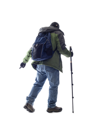 Mountain climber or hiker isolated on a white background for composites. The man is acting like he is climbing something and depicts adventure and extreme sports.