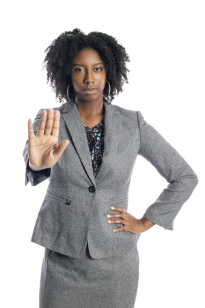 Black African American female businesswoman isolated on a white background doing a stop gesture