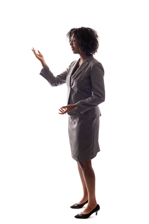 Side View of a Black Businesswoman gesturing like she is speaking or giving a speech like a teacher, presenter or a political candidate campaigning.