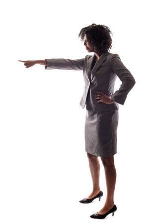 Side view of a Black Businesswoman pointing forward and isolated on a white background