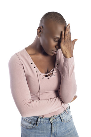 Black african american female model with bald hairstyle wearing a pink shirt on a white background looking upset with mistake and failure