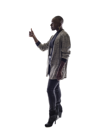 Black female African American model on a white background.  She is holding thumbs up in approval