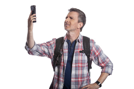 Tourist or traveling hiker unable to get cellphone reception or network.  The man cant make a call or get a rideshare because he has no service or internet. Isolated on a white background. Imagens