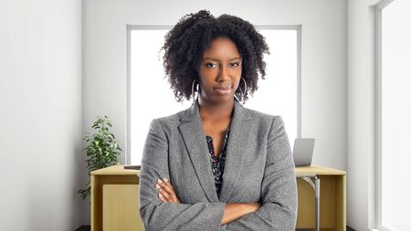 Black African American businesswoman in an office looking disgusted.  She is an owner or an executive of the workplace.  Depicts careers and startup business. Stok Fotoğraf - 127926921