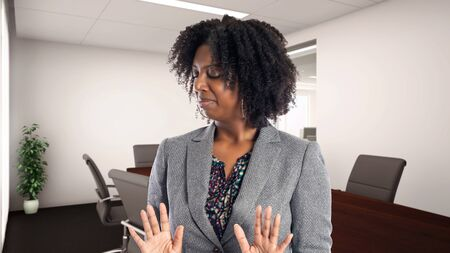 Black African American businesswoman in an office looking disgusted.  She is an owner or an executive of the workplace.  Depicts careers and startup business. Stockfoto