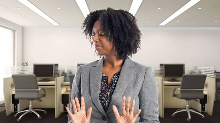 Black African American businesswoman in an office looking disgusted.  She is an owner or an executive of the workplace.  Depicts careers and startup business. Фото со стока