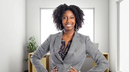 Black African American businesswoman in an office looking confident or arrogant.  She is an owner or an executive of the workplace.  Depicts careers and startup business. Banque d'images